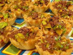I made these tonight!  Yum!  These will be my dessert for Easter dinner.    PISTACHIO BAKLAVA TARTLETS    Melt 5 T butter in skillet over medium heat.  Place 15 mini phyllo shells on a baking sheet.  Bake at 350 for 10 minutes.    Meanwhile, add ½ cup chopped pistachios, ¼ cup honey, ¼ cup sugar, 1 t lemon juice, ¼ t allspice and a pinch of salt to the butter in the skillet.   Cook, stirring until thick, 5 minutes.  Divide among the shells and sprinkle with grated chocolate.