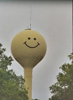 Smiley face water tower overlooking Jessieville, Michigan.