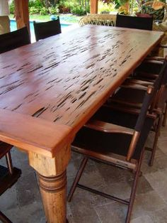 Nice table made out of dead head cypress or pecky wood.  This wood is found on the bottom of rivers where it has been for over a hundred years.  It is expensive and highly sought after.