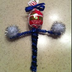 Super cute idea for cheer leading goodie bags! Just wrap pipe cleaners around stick of the sucker and hot glue Pom Pom's to the end of each side. And tie small piece of to ribbon to the top as a bow! Too cute :)