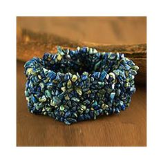 @Overstock - This handcrafted lapis bracelet stretches to slip over the wrist. The jewelry design by Ritu exudes perennial beauty.http://www.overstock.com/Worldstock-Fair-Trade/Handmade-Lapis-Mermaid-Song-Stretch-Bracelet-India/4738208/product.html?CID=214117 $25.59