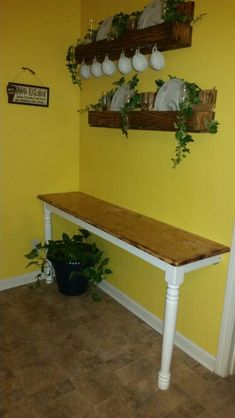 Table attached to wall/ pallet shelves