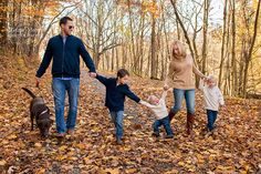 Family holds hands while walking during a family photo session at Mingo Creek Park Pittsburgh PA