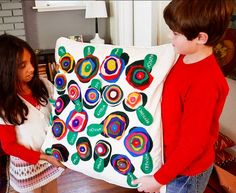 Leave it to the creative geniuses behind Wee Gallery to come up with an auction project any parent would want to display in their home. This throw pillow is actually made up of felt circle flowers anchored by a leaf with each child's name, all sewn on an Ikea pillow cover. Source: Wee Gallery