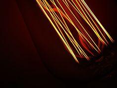 Close-up of our medium cage carbon filament bulb.