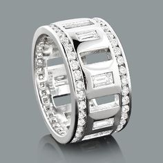 This Designer Diamond Eternity Ring is Custom Made in New York, weighs approximately 8 grams and features 2.78 carats of dazzling baguette and round diamonds. This diamond eternity band is available in Platinum, 18k or 14k yellow, rose, white gold, various sizes, and can be customized with any color and quality diamonds. Price and description is for a ring in 14K gold and size 9, gram weight and diamond amount/carat weight will vary for other sizes. Please note: it will take us 5-7 business…
