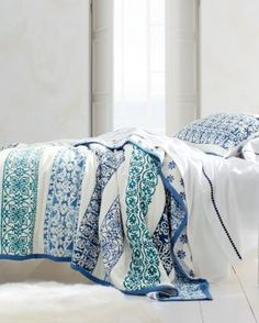 Adorn your bed with the timeless beauty of patterns inspired by Delft tiles of the Netherlands. The hand-quilted strip pieces in rich and regal blues and greens are perfectly underscored by reliefs of bright white. Lightweight quilt with cotton-flannel fill offers all-season comfortQuilt and sham are backed in small tile print; solid bindingSham has back closure with fabric ties100% cottonImportedTwin: 68 x 90Double/Queen: 90 x 90King: 108 x 90 Standard Sham: 20 x 26