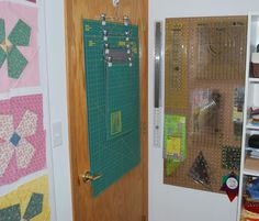 The Double Nickel Quilt;s sewing room. Love this idea for organizing cutting mats!  Also note the peg board to the right.