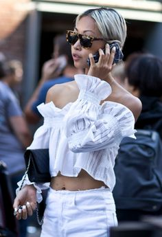All the New York Fashion Week Street Style Outfits You Need to See - Ruffled off-the-shoulder top, white nails, and matching white jeans with tortoise shell sunglasses