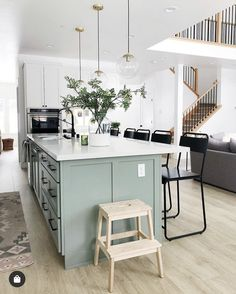 WINNER WINNER: white cabinets, pale green island, light wood floors, white countertops - or butcher block?✨ We don't know what we love more about kitchen, the pale green island or the perfectly placed outlet (perfect for standing… Light Green Kitchen, Green Kitchen Island, Green Kitchen Cabinets, Kitchen Redo, Home Decor Kitchen, Kitchen Interior, New Kitchen, Home Kitchens, Kitchen Remodel