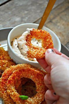 Vegan buffalo onion rings are baked not fried, super crispy, incredibly easy, spicy, and the healthiest way to enjoy some onion rings!