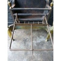 Meat toaster for fire grate (wrought iron). From http://www/firebacks.net