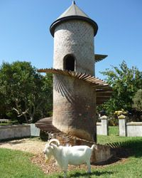 World's Most Trustworthy Wineries:  South Africa: Fairview  It's hard to pin down Fairview's multitalented Charles Back. When he's not experimenting with grape varieties never before grown in South Africa at his Spice Route project or starting foundations to help underprivileged winery workers own land at his Fairview estate, he's engaged in quirky projects like building a tower-like home for the goats on his estate. This later became the inspiration for his affordable Goats Do Roam wines.