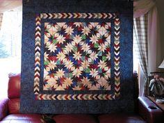 Tsunami quilt in batiks using Deb Tucker Hunter Star ruler.  32 different batiks!