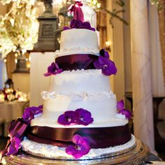 Five-tier white and purple wedding cake | Images by Berit | Cake: Pleasantdale Chateau | www.theknot.com