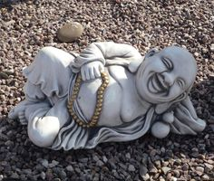 Laying Stone Buddha Statue Large Garden Ornament. Buy now at http://www.statuesandsculptures.co.uk/large-garden-ornaments-laying-stone-buddha-statue
