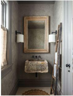 unusual stone sink in rustic bathroom