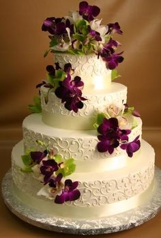 This is so pretty!  Love the contrast of the purple Dendrobium orchids and he white wedding cake! #purpleweddingcakes