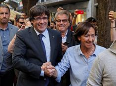 Carles Puidgdemont cheered by his folks in Girona the day after declaring independence.