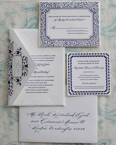 Navy and blind impression letterpress wedding invitations