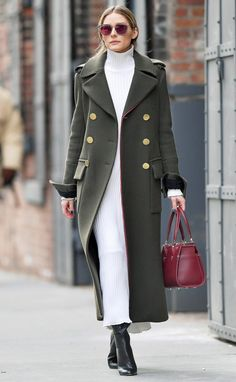 Olivia Palermo in a white turtleneck midi dress, long olive green coat and black booties - click through for more winter outfits