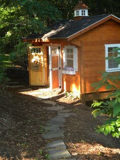 Cute little woodland coop. The colors work great in this setting.#HenHouse    www.FreeHenHousePlans.net