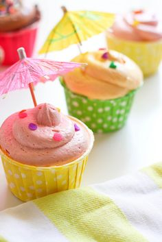 Top cupcakes with paper parasols for a tropical graduation party.