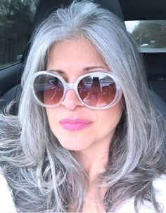 Renae Scartabello. Love this lady's natural grey hair. She is naturally beautiful.