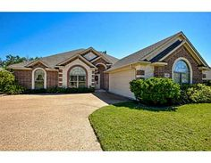2449 Newark, College Station, TX This gorgeous home is waiting for you to call it home with features like an open concept living, kitchen, breakfast area that boast tile flooring & lovely granite counters with tons of cabinet & counter space! Expansive master bedroom boasts a spacious bathroom featuring a garden tub, separate shower & huge walk in closet.  Enjoy peaceful evenings on the covered patio with views of trees, birds, and squirrels! See it before it's gone! Realtor: Farrah Spears