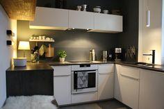 Black walls against a white kitchen