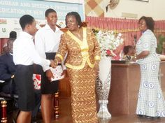• Professor Opoku-Agyemang congratulating Adwoa Debrah, one of the two candidates who scored nine ones in this year's BECE. Standing next to her is Vanessa Obro, the other candidate, who also scored nine ones, while Rev Simpson (right) looks on.