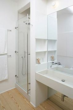 build out wall between shower and vanity for storage options