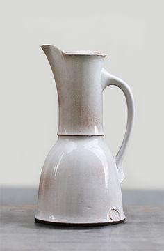 "A beautifully proportioned & elegant pitcher. All my research has said: ""Pottery pitcher Dílo."" Provenance & maker unknown. So sad. Anyone?"