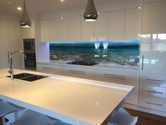 Impression kitchen splashback and here we have a beach scene. #kitchensplashbacks