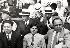 Al Capone enjoy a baseball game with his kid, at left Illinois legislator Roland V. Libonati and behind them Fred Pacelli and Machine Gun Jack Mcgurn. Real Gangster, Mafia Gangster, Al Capone, Italian Mobsters, Albert Anastasia, Baby Face Nelson, Chicago Outfit, Chicago Pictures, Guys And Dolls