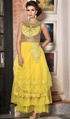 Get a dazzling look dressed in this yellow embroidered net sleeveless gown. The butta, lace, moti, patch, resham and stones work looks chic and fantastic for any function. #FabulousDesignPartyGown