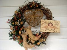Victorian Christmas handmade grapevine wreath decorated with dried flowers, a gold heart and an angel plaque