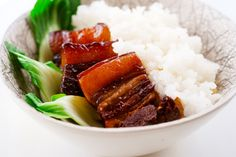 "In America, comfort food usually means burgers, fries, chicken pot pies,  but growing up in a Chinese household it was more like fried rice,  stir-frys and red braised pork belly or ""Hong Shao Rou"".   I would beg my mom to make red braised pork belly on every occasion  possible. I'd m"