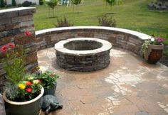 Firepit with veneer and sitting wall.
