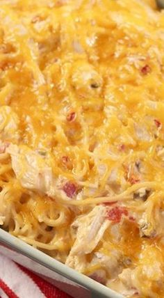 Creamy chicken spaghetti made with rotisserie chicken, Rotel tomatoes, Velveeta Cheese, and cream of mushroom and cream of chicken soups. This easy chicken spaghetti recipe is ready in 30 minutes. This is serious comfort food! Huhn Spaghetti, Chicken Spaghetti Casserole, Chicken Spaghetti Recipes, Mexican Chicken Spaghetti, Chicken Spaghetti Velveeta, Chicken Soups, Chicken Rotel Recipes, Velveeta Recipes, King Ranch Chicken Casserole