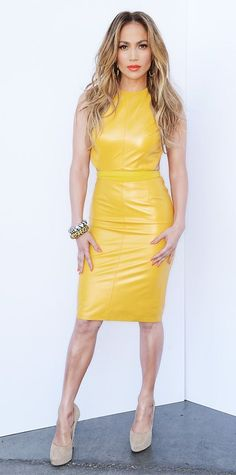 J-Lo wearing a long yellow vinyl dress.: