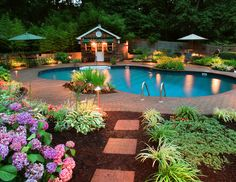 Love the mix of hostas and hydrangeas...pool's not too hard on the eyes either!