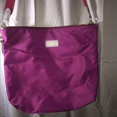 Cole Haan Messenger Bag! Really light messenger bag. Pinkish purple color and same color strap! Great condition, no stains at all! You can fit a folder or notebook. Offer something.  Price is negotiable. Or trade for a wallet! Cole Haan Bags Crossbody Bags