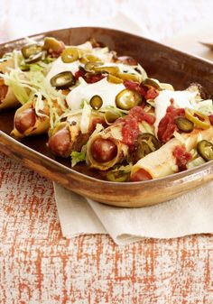 Dressed Up Hot Dog Flautas -- Dressed up with salsa and pickled jalapeno slices, this delicious recipe is dinner table-ready in just 20 minutes total!