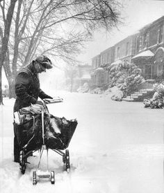 The Great 1967 Chicago Blizzard. Despite blizzard conditions, mailman Larry Bishop continues along his route on 83rd Street just west of Hermitage.