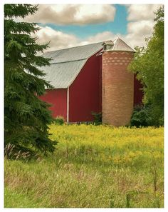 A typical Wisconsin red barn is mated with an atypical red brick silo just south of Scandinavia, Wisconsin. The couple stands as a sentry to an agricultural past.
