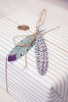 Paper feather gift toppers.