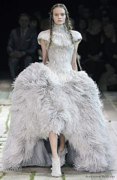 Some of our favorite looks from Alexander McQueen's Spring/Summer 2011 ready-to-wear collection. An exotic bird of a dress