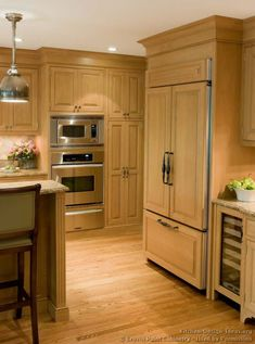 #Kitchen of the Day: Traditional light wood kitchens. (By Crown Point Cabinetry). Excellent, light wood panelized refrigerator wood floor