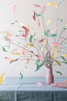 PASTEL FEATHER TREE – Not all Easter decor has to be egg-centric. Branches from the backyard and pretty paper leaves make for quite the springtime display. Click through for the entire gallery and for more easter decorations.